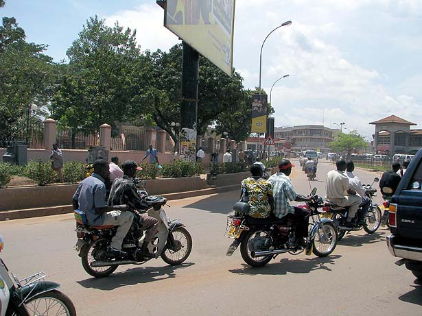Passengers on a boda bodas in Kampala