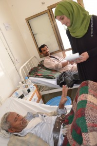 Malak Shaher interviews a patient