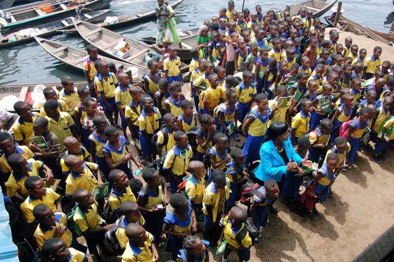 Betty Abah, CEE-HOPE's founder and 2006 fellow (in front) with pupils in a school in Makoko, a slum community in Lagos, Nigeria.